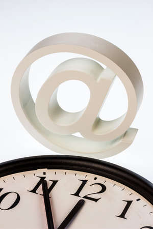 edv: a clock that 11:55 shows and an e-mail: symbol photo for reform of data protection Stock Photo