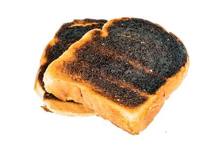 burnt toast: toast was burned during toasting. burnt toast at breakfast. Stock Photo