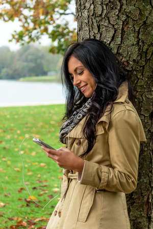 hark: a young woman listens to music with your phone. talking on the mobile phone. Stock Photo