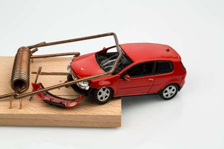 fully comprehensive: a model car in a mousetrap, symbol photo for car expenses and liabilities Stock Photo