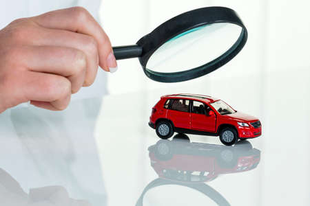a model of a car is examined by a doctor. photo icon for workshop, service and car purchase.