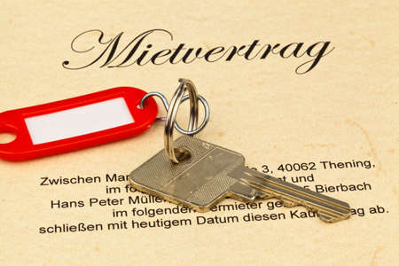 immobilien: the key of an apartment and a lease in german Stock Photo