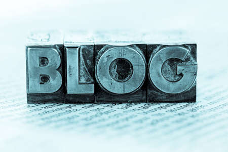 the word blog written with lead letters. photo icon for blogging