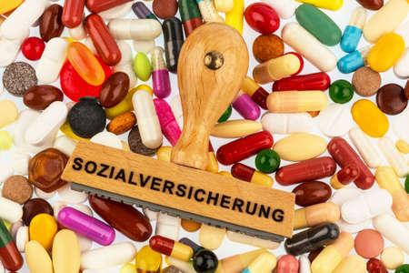 reimbursement: stamp on colorful tablets symbolfot for social security, drugs and reimbursement