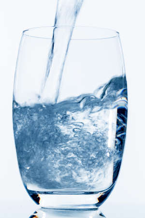 hydrology: water is poured into a glass, symbol photo for drinking water, freshness, demand and consumption