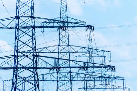energy needs: pylons of a power line. pylons for electricity.