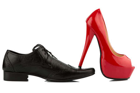 Women s shoes: ladies shoe on mens shoe, symbol photo for separation, divorce and conflict Kho ảnh