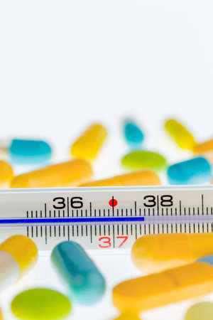 colds: a thermometer and tablets. symbolic photo for flu and colds Stock Photo
