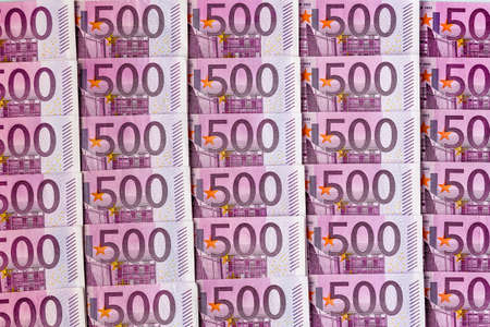 adjacent: many five hundred euro banknotes are adjacent. photo icon for wealth and investment