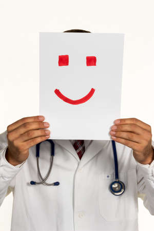 joie: a doctor holds a smily front of your face Stock Photo