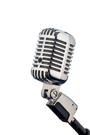 micro recording: an old retro microphone in front of a white background. Stock Photo