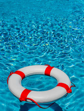 banking crisis: an emergency tire floating in a swimming pool. symbolic photo for rescue and crisis management in the financial crisis and banking crisis. Stock Photo