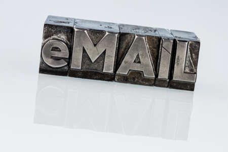 edv: the word e-mail in lead letters written. photo icon for quick correspondence