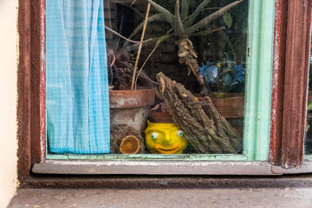immobilien: various objects in the window of an apartment