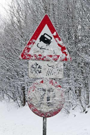 skidding: a verscheites road signs skidding in winter