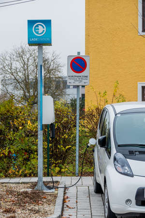 pkw: electric car at charging station, symbol of ecology, environmental protection, innovation