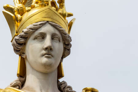 athene: parliament in vienna, austria. seat of government. statue pallas athena, goddess of weiheit.