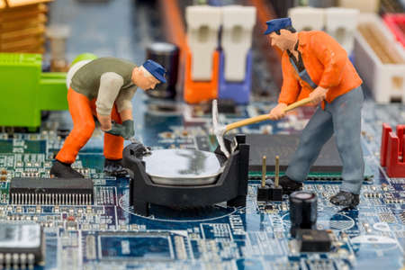 hard drive crash: computer board and worker, symbol photo for computer failure, maintenance, data security Stock Photo