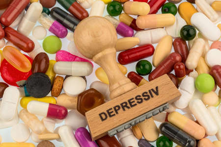 stamp on colorful tablets photo icon for depression, therapy and psychotropic drugs
