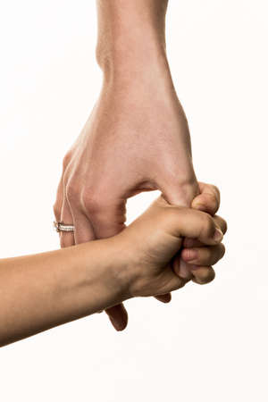 solicitous: small and large hands, symbolism trust, protect, security Stock Photo