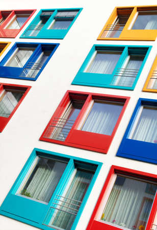 colorful facade of modern apartment building, symbol of housing, rental, anonymity, big city Stock Photo