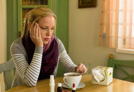bedridden: woman on sick leave with tea and medicines. cold, cold and flu season