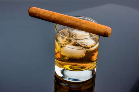 investigated: cigar and whiskey. an icon photo for addiction and related Stock Photo