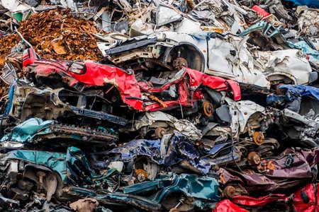 sponsoring: old cars were scrapped in a trash compactor. scrap iron and scrap bonus for car wrecks