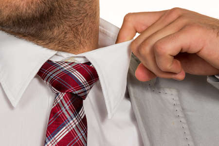 cheated: a man (manager) feels concentrated. the collar bursts.