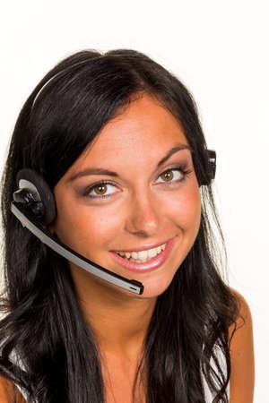 een jonge vrouw in een mcc belde de klant met een hoofdtelefoon Stockfoto