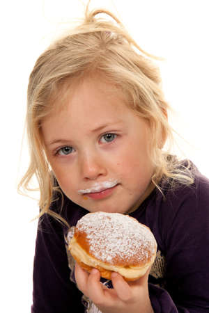 children eating: child in carnival with donuts. faschingskrapfen
