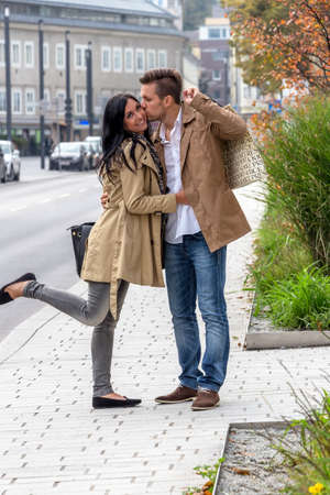 stroll: a young couple with stroll through the streets Stock Photo