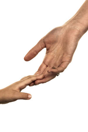 responsibly: small and large hands, symbolism trust, protect, security Stock Photo