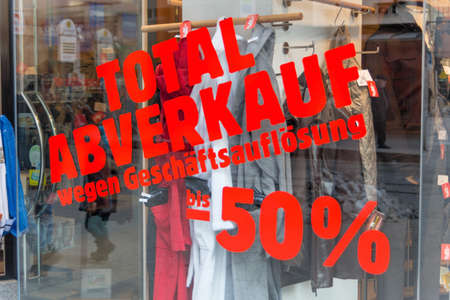 liquidation: total sales for liquidation. symbolic photo for bankruptcy and retirement.