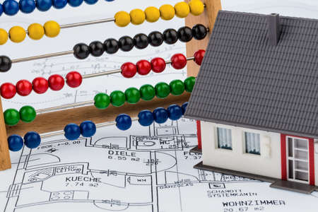 immobilien: house, abacus, plan, symbol photo for house construction, financing, building society