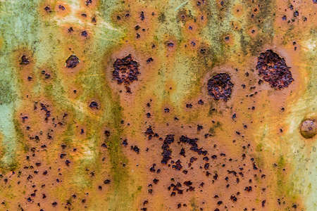 corrode: iron with traces of rust, symbol of decay, damage, perishability