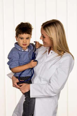 heart failure: physicians and little boy, a symbol of disease, diagnosis, heart failure Stock Photo