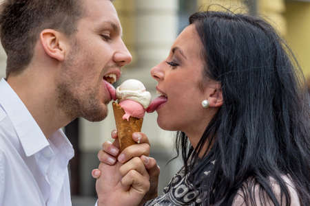 leis: a young couple with a bag of ice. ice cream cones as a refreshment in summer Stock Photo