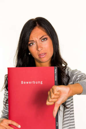 collective bargaining: a young woman holding a folder for the application in an open job in hand.