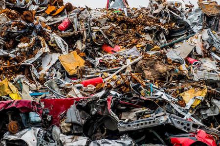 scrap iron: old cars were scrapped in a trash compactor. scrap iron and scrap bonus for car wrecks