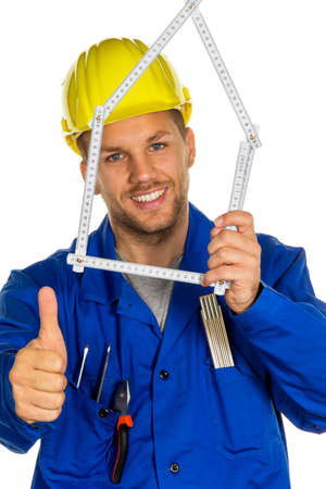 work worker workforce world: a worker in a business enterprise (craftsmen) with helmet wants to build a house. Stock Photo
