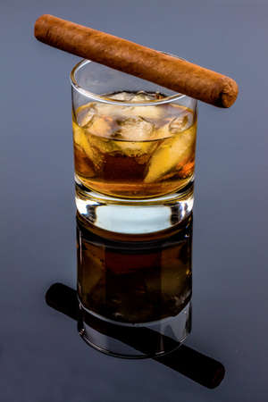 studied: cigar and whiskey. an icon photo for addiction and related Stock Photo