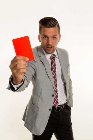 resignation: a manager holding a red card in hand. symbolic photo for resignation or dismissal Stock Photo