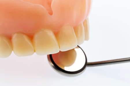 hospital expenses: teeth and mouth mirror, symbol photo for dentures, diagnostics and copayment
