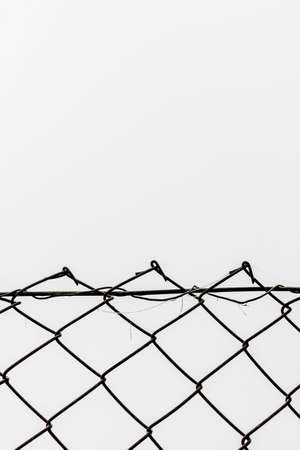 stretchy: chainlink fence against white background, symbolizing border network, space