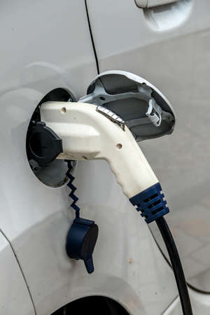 pkw: electric car at charging station. symbol of ecology, environmental protection, innovation