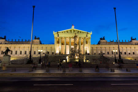 athene: parliament in vienna, austria. seat of government. night scene with athene