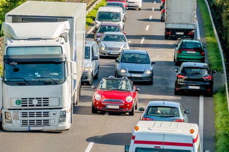 congestion: cars and trucks stuck in traffic, symbol of commuter traffic, congestion, mobility