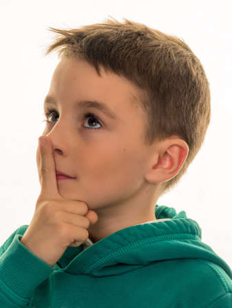 skepticism: a boy thinks. pensive or curious child.