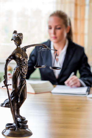court process: businesswoman sitting in an office. photo icon for managers, self-employment or lawyer.